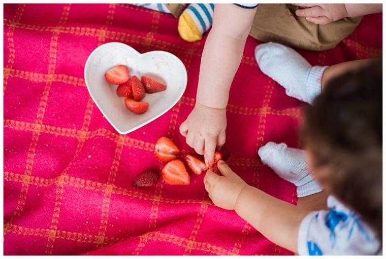 babies-reaching-for-strawberries-in-a-heart-shaped-bowl
