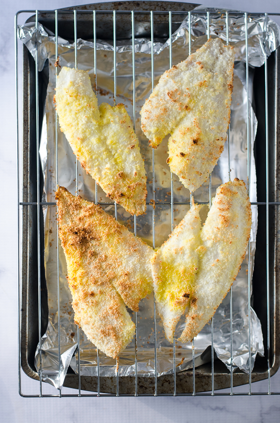 Parmesan-crusted flounder that is flakey, buttery and crispy all at the same time! Dipped in egg, then coated in a Parmesan and coconut flour mixture, and gently baked in the oven. Low-carb, ketogenic, gluten-free, grain-free, pescatarian.