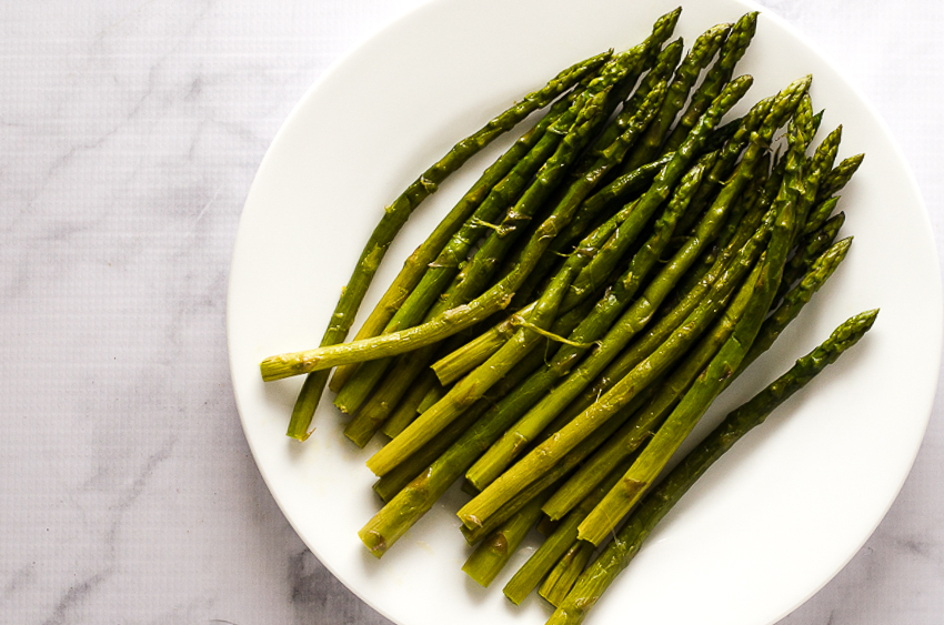 This super-tender buttered asparagus is incredibly delicious and has none of the stringiness of poorly cooked asparagus. Very tender, delicious and incredibly simple! Ready in just under 20 minutes. Gluten-free, grain-free, low-carb, ketogenic, Bulletproof.