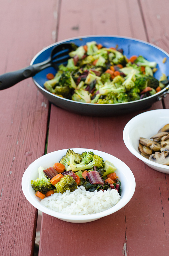 A simple and quick recipe, this orange ginger veggie stir fry is perfect for busy nights! Takes less than 30 minutes, and can be made in just one skillet! Gluten-free, grain-free, dairy-free, vegan, vegetarian, low-carb, Whole30, Paleo.