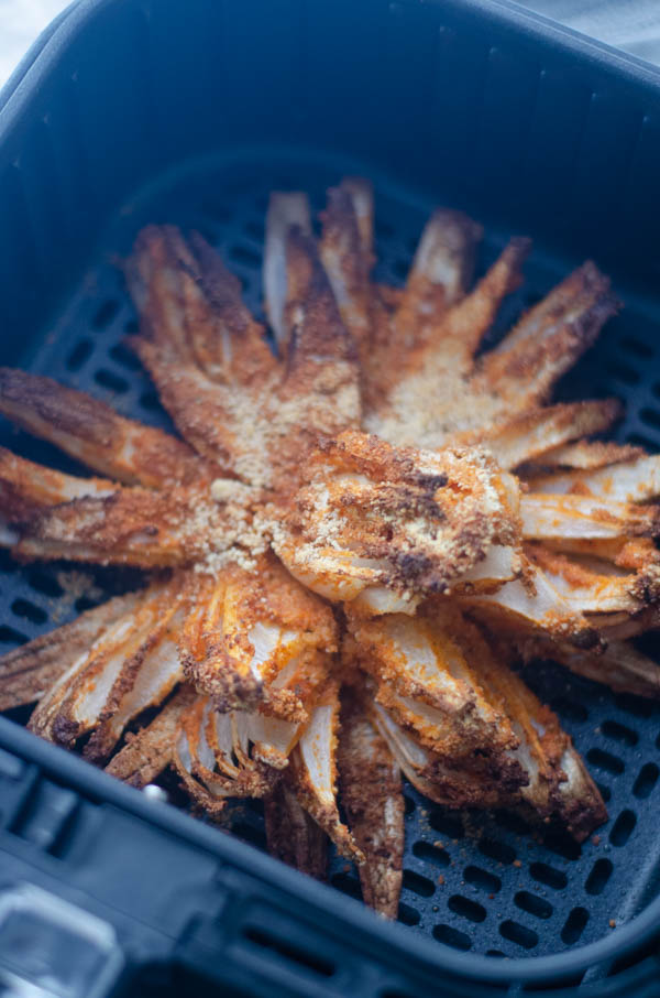 A delicious appetizer for special occasions, this air-fried blooming onion is a much healthier version of a favorite crunchy treat. Paleo, vegan, gluten-free.