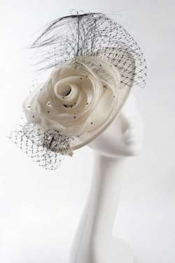 sinamay disc hat with sinamay flower, nett & feather trim in ivory with black