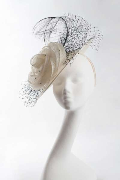 sinamay disc hat with sinamay flower, nett & feather trim inivory with black