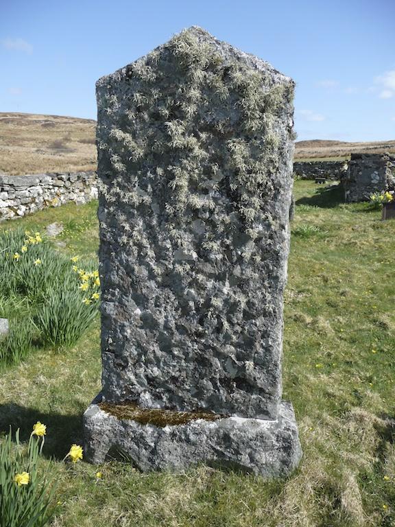 Lichen-covered gravestone