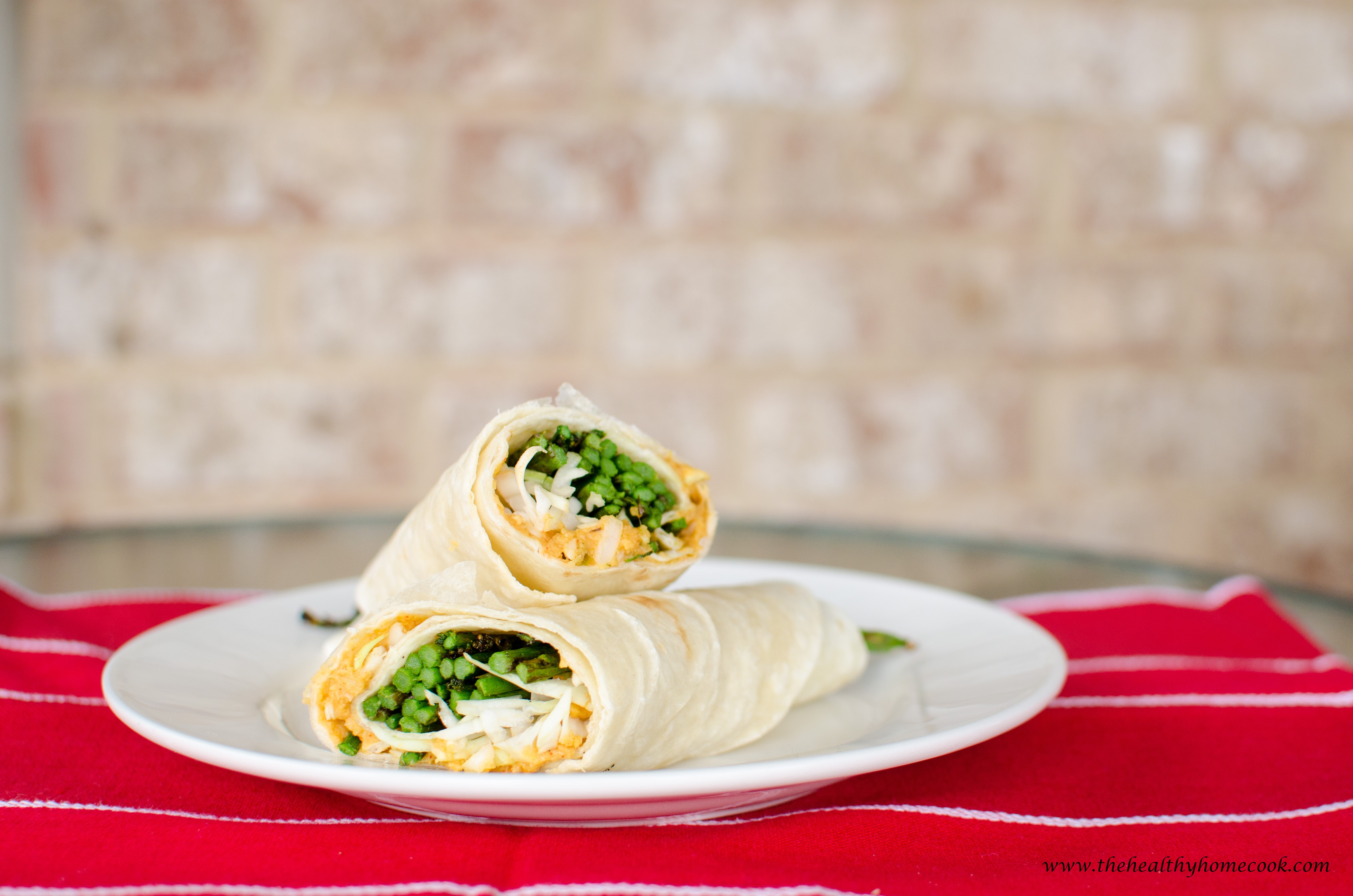 This Grilled Asparagus Wrap Filled With Jalapeno Hummus, Grilled Asparagus,  And Crunchy Cabbage Is