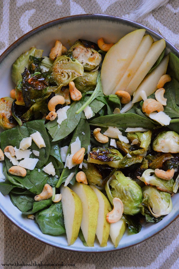 This Spinach Pear Salad with Roasted Brussels Sprouts will rival any fancy restaurant salad out there. Enjoy it as an entree or a side dish for your next weeknight meal.