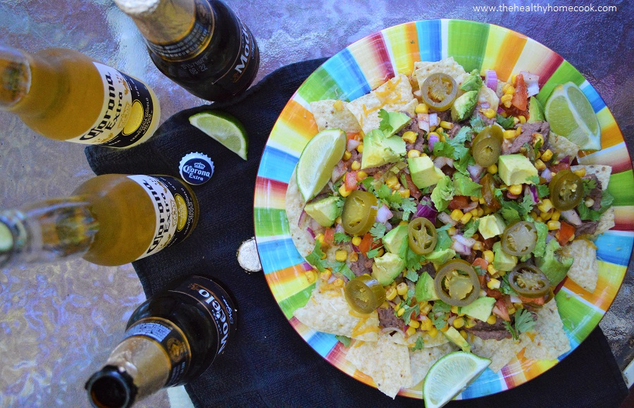 This recipe for Ultimate Vegan Nachos is the perfect addition to your Cinco de Mayo party!