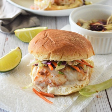 Oven Baked Cod Sandwich- A delicious fish sandwich piled high with fresh slaw and a lime aioli sauce. Perfect for a quick weeknight dinner.