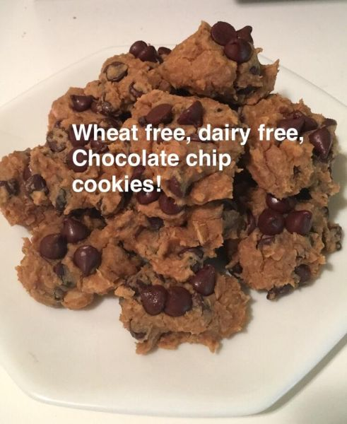 A white plate full of chocolate chip cookies.