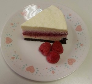 raspberry cheesecake with fresh raspberry garnish