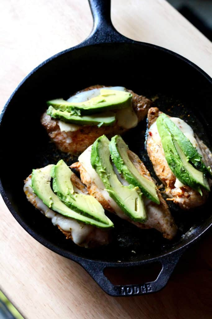 Baked avocado fiesta chicken in cast iron skillet