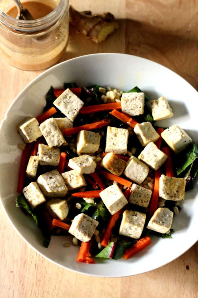 Roasted tofu and carrot bowl with side of ginger peanut sauce