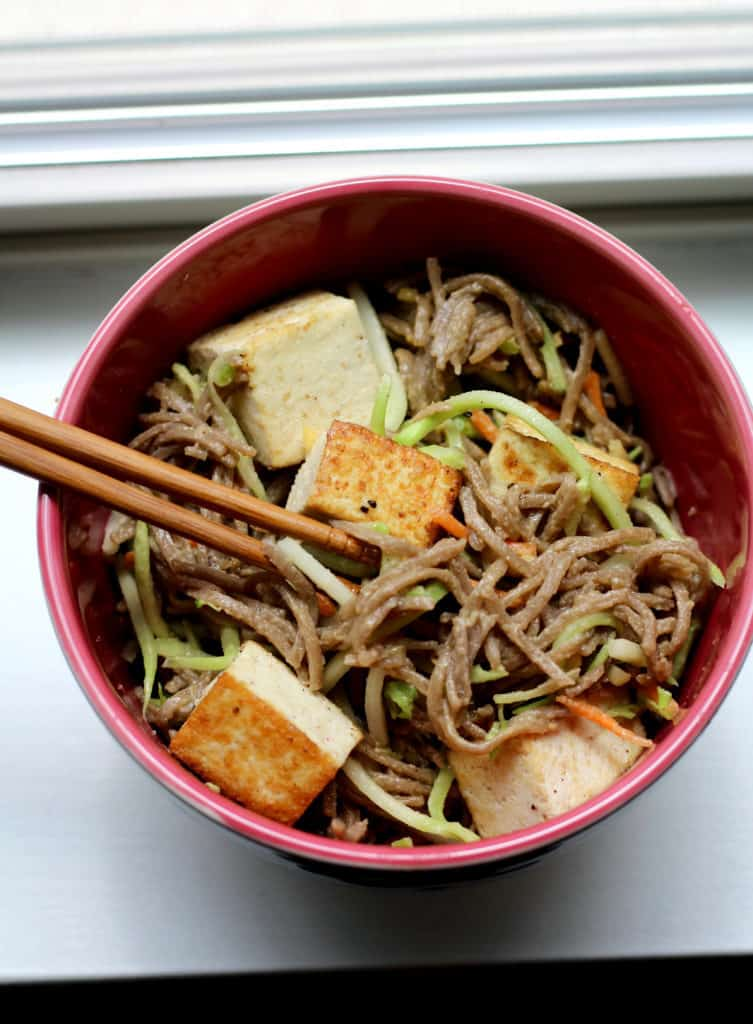 Bowl of cold soba noodles with lemon almond dressing and tofu