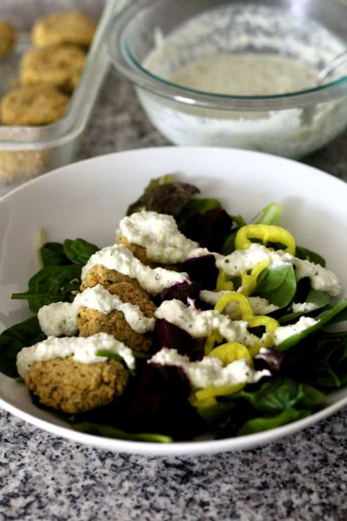 Beet falafel salad with banana peppers and spinach