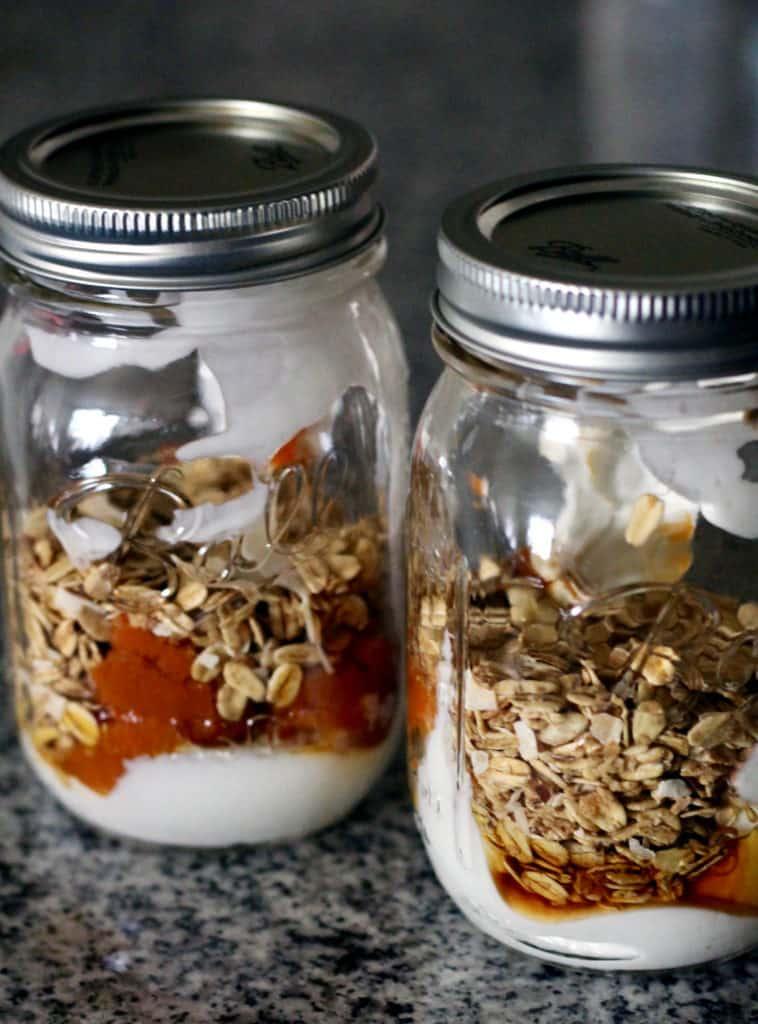 Almond butter, granola, and greek yogurt in a mason jar
