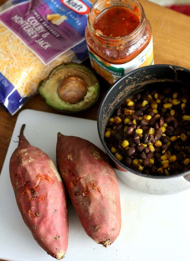 Sweet potatoes, bean and corn mixture, avocado, cheese and salsa