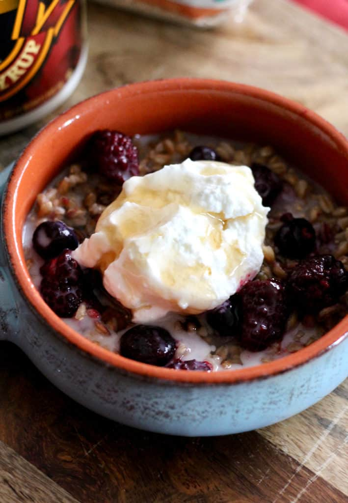 Maple farro breakfast bowl with greek yogurt and berries