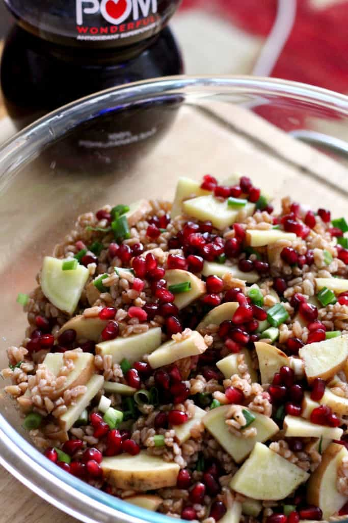 Pomegranate sweet potato farro mixture in large mixing bowl