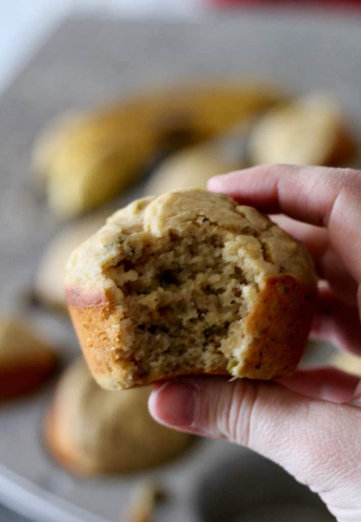 Bite out of whole wheat banana pistachio muffins