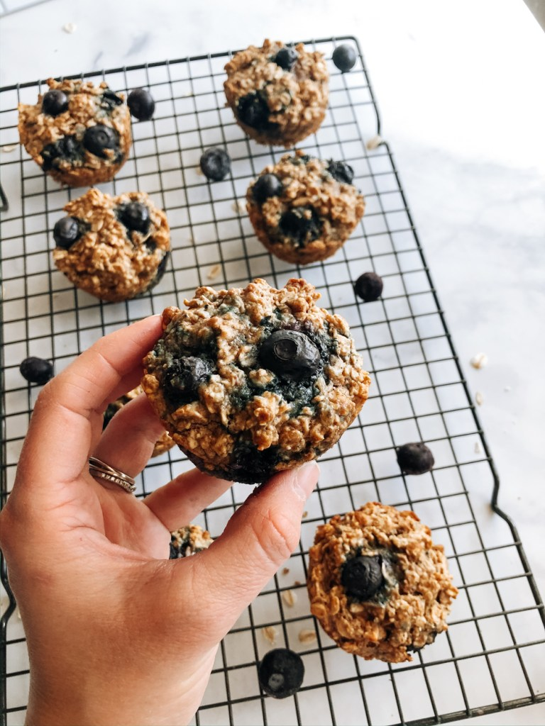 Holding a blueberry almond oatmeal muffin