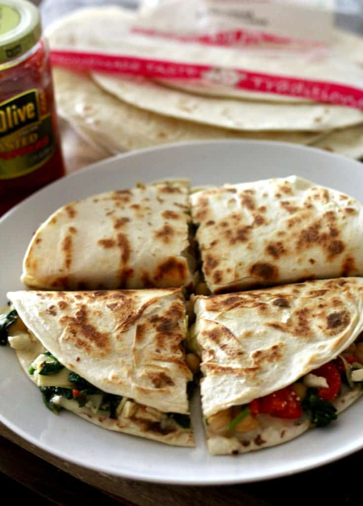 Greek quesadilla cut into quarters