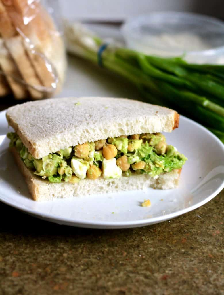 Smashed chickpea avocado sandwich on sourdough bread