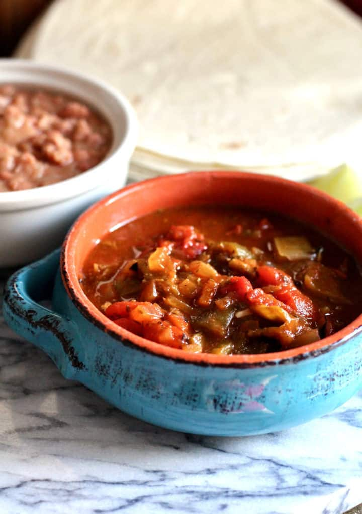 New Mexico-Style Vegetarian Green Chili with refried beans and tortillas