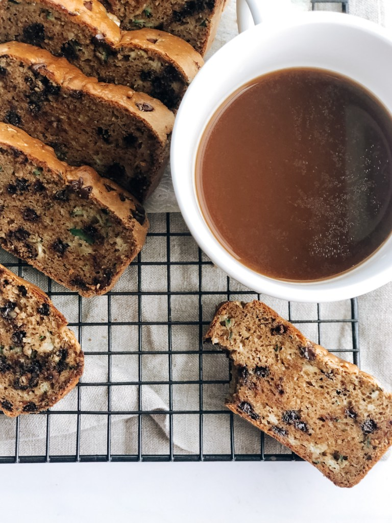 Slice of high protein zucchini bread with coffee