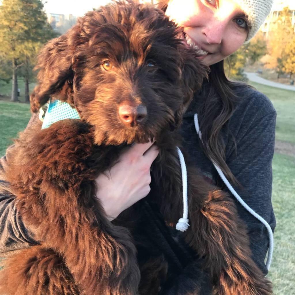 Kelli holding puppy