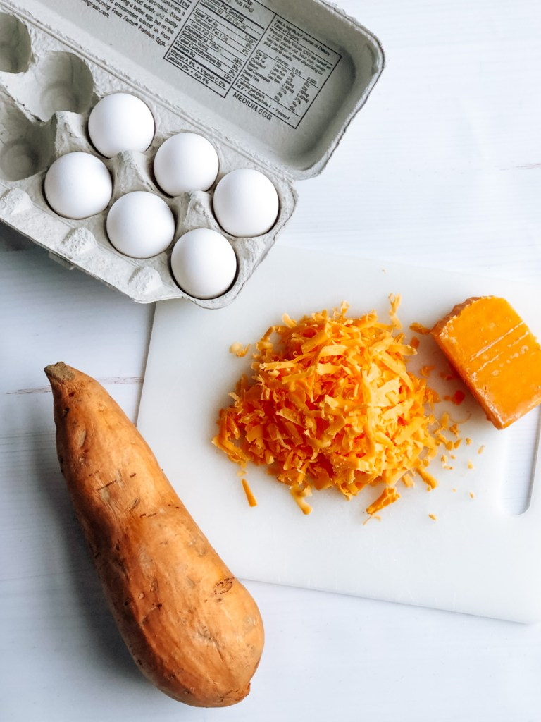 eggs, shredded cheese, and sweet potato