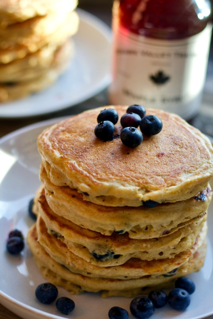 Stack of super fluffy greek yogurt and blueberry pancakes