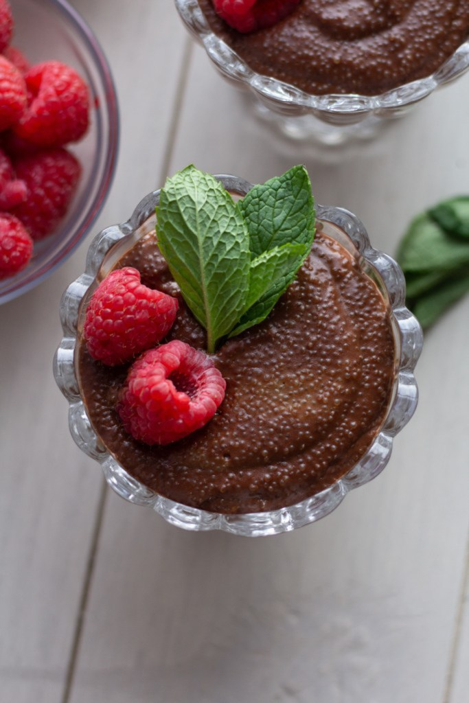 Bowl of dark chocolate amaranth pudding with raspberries and mint