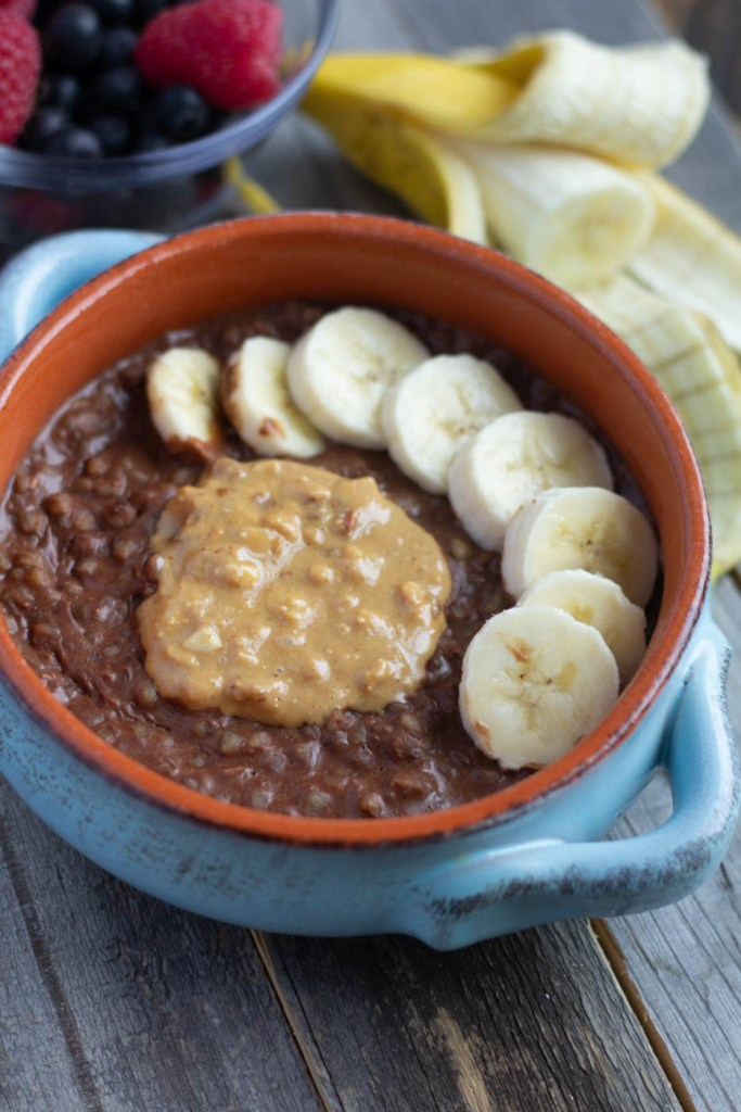 Chocolate peanut butter buckwheat breakfast bowl with banana slices
