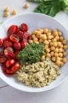 Mediterranean Pesto Bowl with roasted balsamic cherry tomatoes, homemade walnut pesto, chickpeas and freekeh