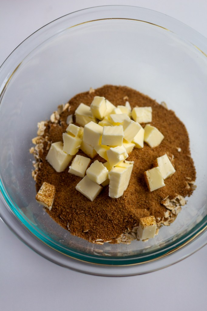 Adding cubed butter to crumble topping ingredients