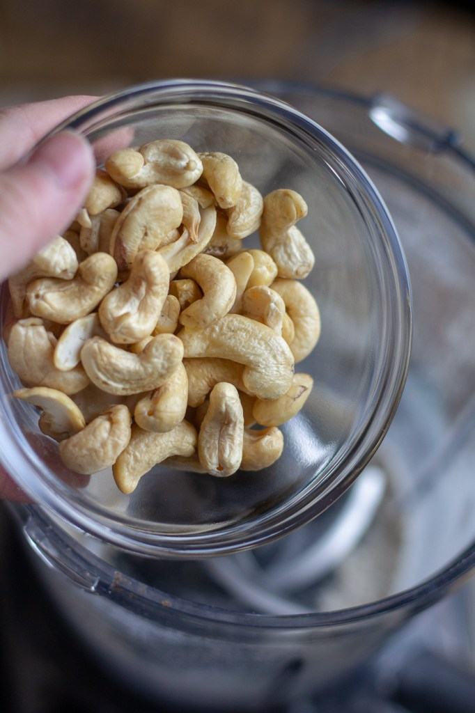 Pouring cashews into food processor