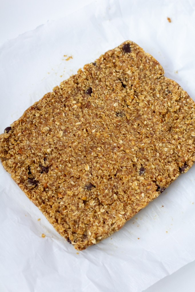 Removing healthy flax seed and peanut butter energy bars from pan