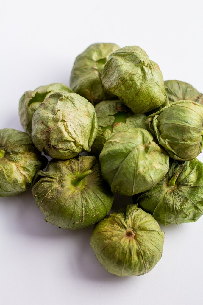 Pile of tomatillos in husks