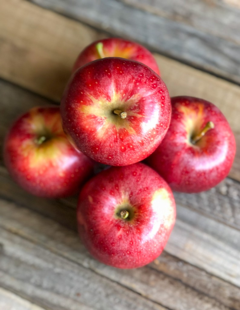 Stack of bright red gala apples