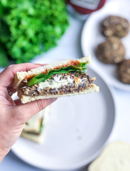 Holding Vegan Black Bean Jalapeno Popper Burger