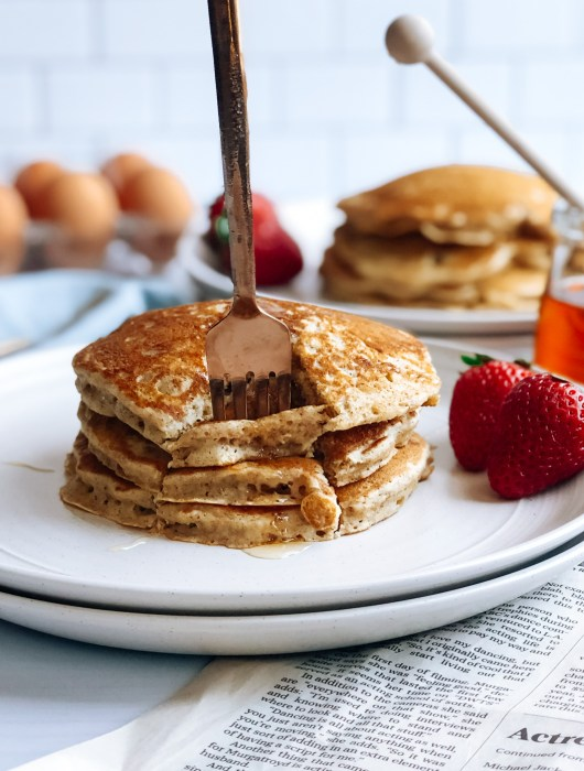 Fork into stack of healthy honey flapjacks