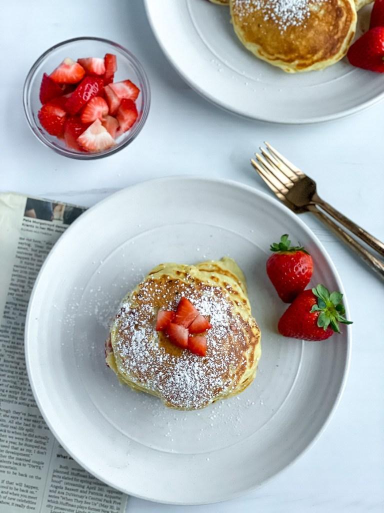 top down view of healthy greek yogurt pancakes with strawberries