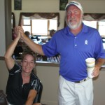 Kirk Blaszyk and Julie Gortsema, both of Glenwood Springs, celebrate after finishing first gross in last weekend's couples tournament. They were the overall winners.