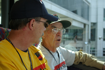 Steve Allen, left, accompanies his father, Tom, during a bus ride to visit one of the war memorials.