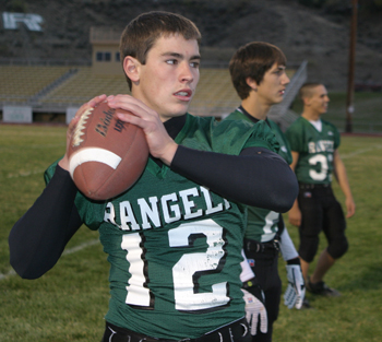 Senior quarterback Patrick Phelan warms up before his last home game. Phelan scored two touchdowns to lead the Panthers to a come-from-behind win against West Grand.