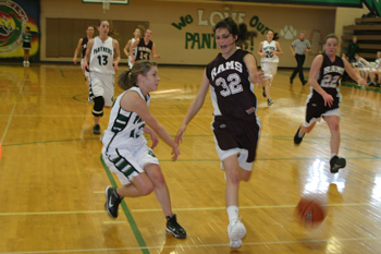 Rangely senior Audrey Hogan bounced a pass to a teammate during Saturday's league-opening win against Soroco. Hogan led the Lady Panthers with 18 points.