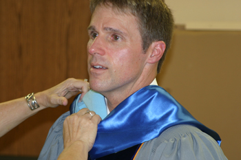 """Rangely Superintendent Barry Williams received a helping hand before Sunday's graduation. He congratulated the seniors on their """"great success."""""""