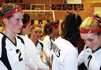 Meeker volleyball players huddled up before last Friday's homecoming match against Hayden.