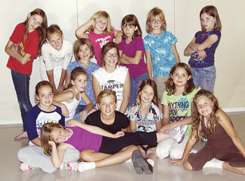 """Miss Hannigan with the orphans from the cast of """"Annie Jr."""""""
