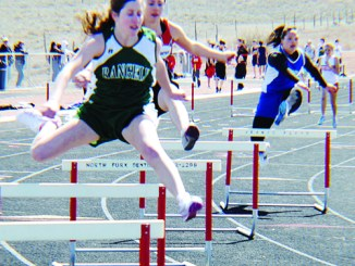 Photo by Amanda Aehehart. Freshman Aimee Hogan finished eighth in both the 100- and 300-meter hurdles.